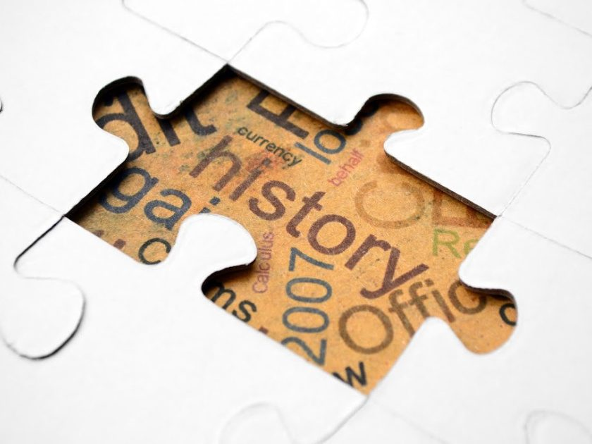 "white puzzle with one piece missing and the word ""history"" underneath"