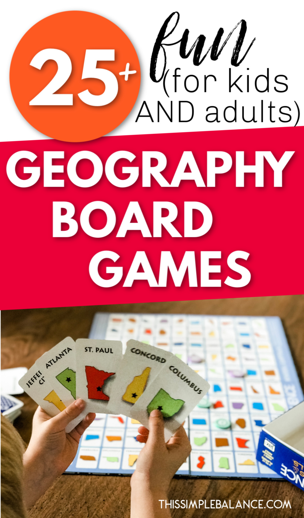 boy holding up cards while playing geography board games
