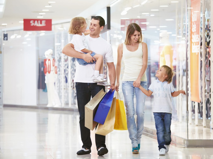 family shopping for sales in the mall