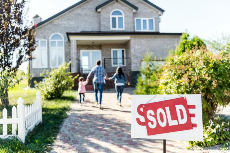 family buying upsized home