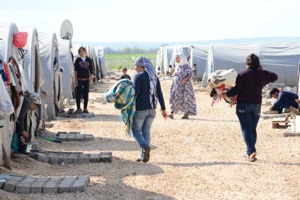 refugees walking in refugee camp