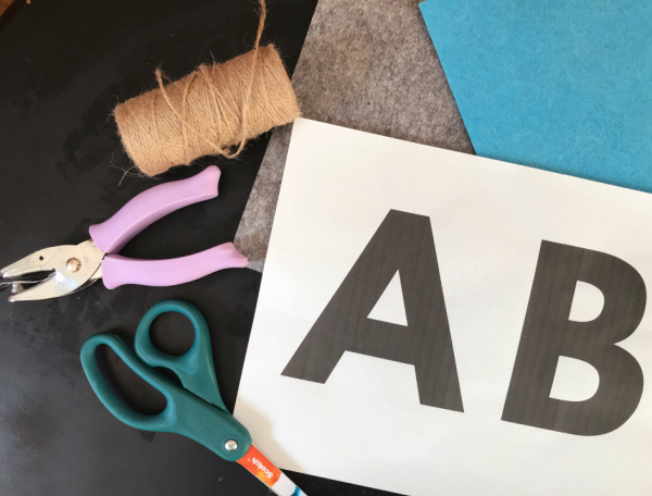 supplies for DIY alphabet banner on table