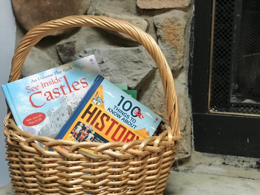 basket on fireplace holding usborne homeschool books