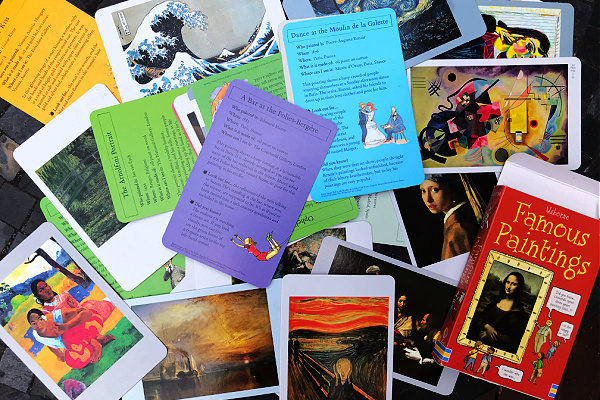 Usborne famous painting cards spread out on table