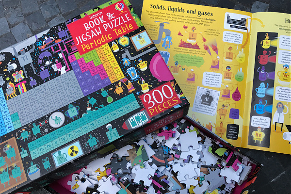 Usborne periodic table jigsaw puzzle and book, cover of the box with page of accompanying book