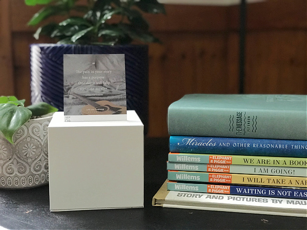 authenticity calendar on table with books and plants