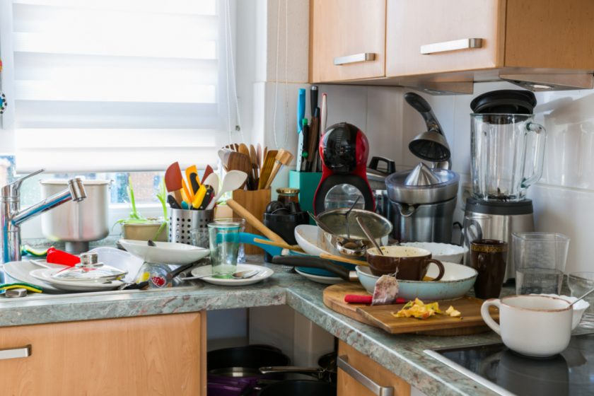dishes piled up in homeschool family kitchen